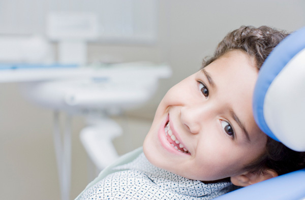 Young boy smiling with healthy teeth
